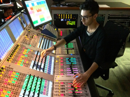 Trabalhar como técnico de áudio na Globo.